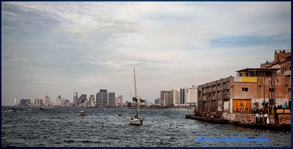 Yaffo port's entrane with modern day Tel Aviv in the